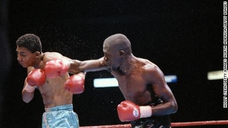 Mayweather (right) and Fidel Avendano trade blows during a bout.