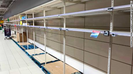 TOPSHOT - This picture taken on March 14, 2020, shows empty stalls in a supermarket in Brussels, during the COVID-19 outbreak caused by the novel coronavirus. - Belgium close schools, cancel all cultural events and shutter bars and restaurants to stave off the spread of the coronavirus outbreak.  Beginning on March 14, only stores that provide essential services, such as pharmacies and grocery stores, will remain open under normal conditions. (Photo by François WALSCHAERTS / AFP) (Photo by FRANCOIS WALSCHAERTS/AFP via Getty Images)