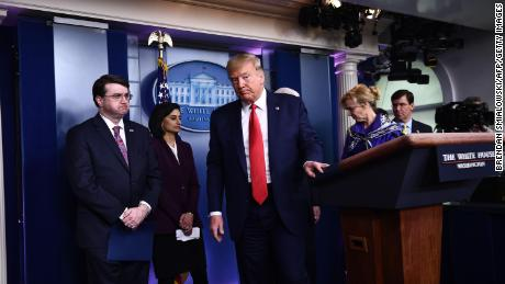 US President Donald Trump leaves after the daily briefing on the novel coronavirus, COVID-19, at the White House on March 18, 2020, in Washington, DC.