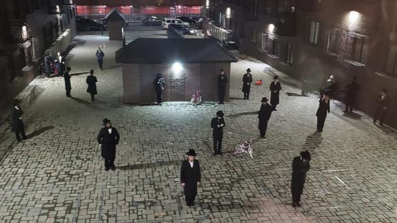 """Hasidic Jewish men take part in a <a href=""""https://jewishinsider.com/2020/03/white-houses-avi-berkowitz-implores-hasidic-leaders-to-follow-coronavirus-measures/"""" target=""""_blank"""" target=""""_blank"""">""""social distancing"""" minyan</a> in New York on Tuesday, March 17."""