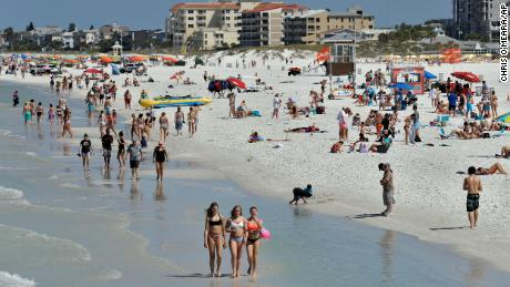 'Get off the beach': Florida's governor under pressure as images of crowded beaches go viral
