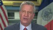 NYC schools: The mayor and governor are at odds over whether they're closed for the school year