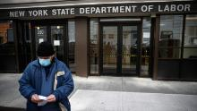 Visitors to the Department of Labor are turned away at the door by personnel due to closures over coronavirus concerns.