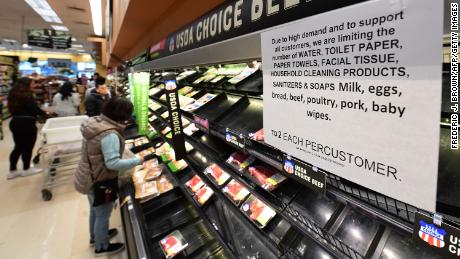 Some retailers are limiting purchases of some items in an attempt to stop customers from hoarding. (Frederic J. Brown/AFP/Getty Images)