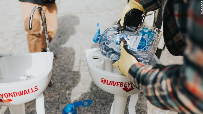 The Love Beyond Walls nonprofit cleans each portable sink daily. It also refills the water and soap containers and makes any necessary repairs.