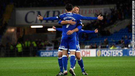 Whittingham is congratulated by Rickie Lambert after scoring a free kick against Sheffield Wednesday.