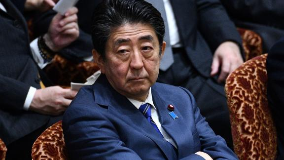 Japanese Prime Minister Shinzo Abe attends a parliamentary session in Tokyo on March 2, 2020.