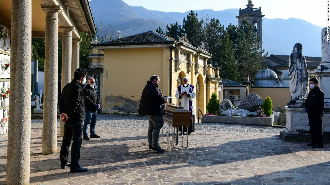 A funeral service is held without family members in Bergamo, Italy, on March 21.