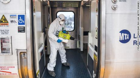 Hicksville, N.Y.: A Long Island Rail Road employee disinfects a train car with an eco-friendly cleaner while at the Hicksville, New York LIRR station on March 19, 2020. (Photo by Steve Pfost/Newsday RM via Getty Images)