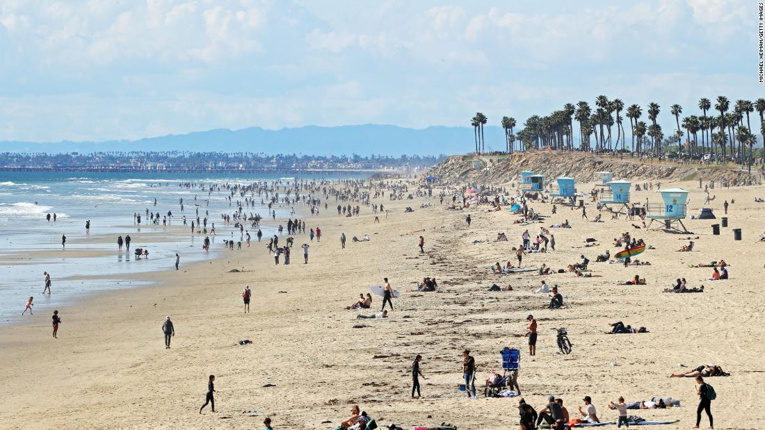 "People are seen on California's Huntington Beach on March 21. Crowds descended on California beaches, hiking trails and parks over the weekend <a href=""https://www.cnn.com/2020/03/23/us/california-stay-at-home-beach-goers/index.html"" target=""_blank"">in open defiance of a state order</a> to shelter in place and avoid close contact with others."