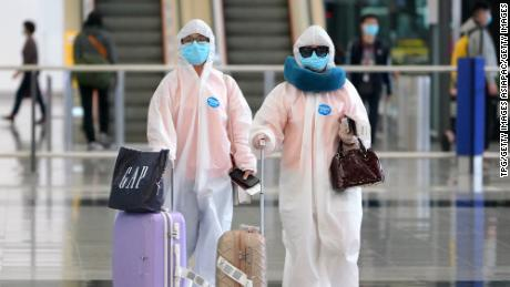 Arrivals at Hong Kong airport on March 18 seen wearing heavy protective gear against the novel coronavirus.