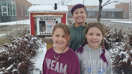 Shelly Anderson's kids; Claire, 7  Caleb, 11 and Emma, 8 help keep their Little Free Pantry stocked.