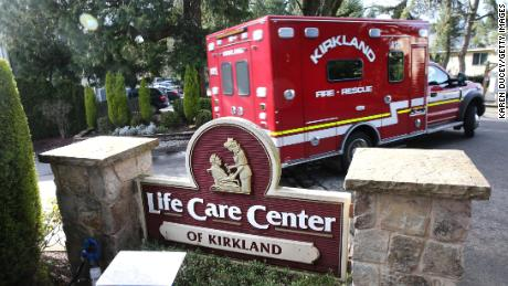 An ambulance leaves the Life Care Center in Kirkland, Washington.