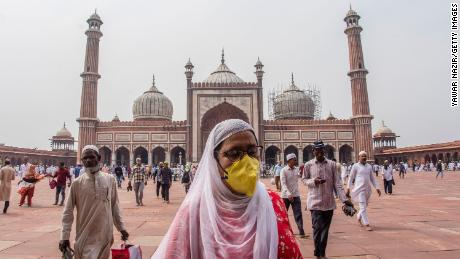 A Indian Muslim woman wears a protective mask as she leaves Friday prayers at the historic Jama Masjid on March 20, 2020 in Delhi, India.