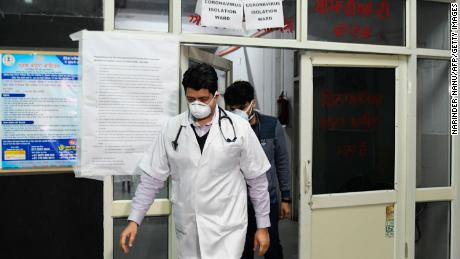 "Doctors are seen in front of an insloation ward for COVID-19 coronavirus, at Guru Nanak Dev hospital in Amritsar on March 7, 2020. - The World Health Organization called the spread of the virus ""deeply concerning"" as a wave of countries reported their first cases of the disease -- which has now killed nearly 3,500 people and infected more than 100,000 across 92 nations and territories."
