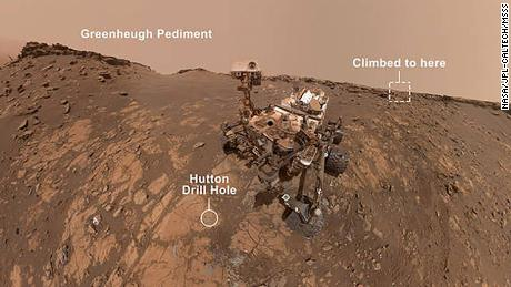 "This selfie was taken by NASA's Curiosity Mars rover on Feb. 26, 2020 (the 2,687th Martian day, or sol, of the mission). The crumbling rock layer at the top of the image is ""the Greenheugh Pediment,"" which Curiosity climbed soon after taking the image. Credits: NASA/JPL-Caltech/MSSS"