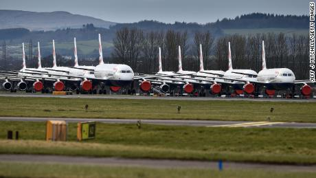 A grounded fleet of British Airway planes sit on the runway at Glasgow Airport.