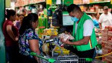 A cashier wears a face mask at a supermarket in Managua, Nicaragua.