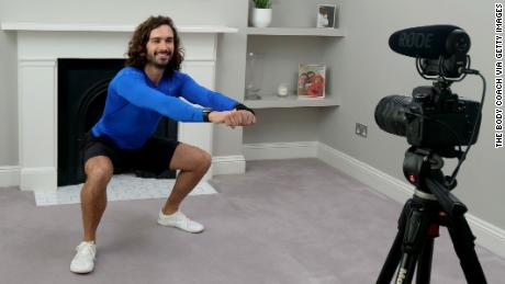 Joe Wicks, aka The Body Coach, teaches the UK's school children physical education live via YouTube on March 23 from his home in London.