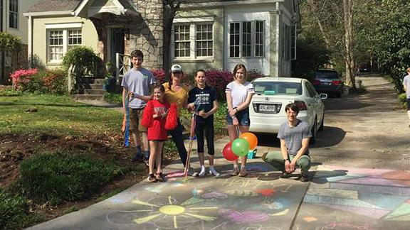 About a dozen families came together to do something special at each stop on 16-year-old Carrie Crespino's birthday walk through her Decatur, Georgia neighborhood.
