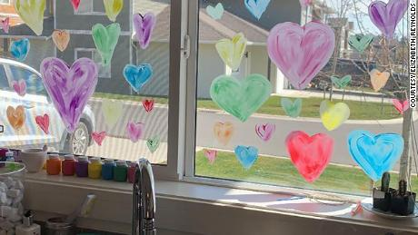 Elizabeth Reynolds and her 2-year-old child filled the window of their home in British Columbia with colorful hearts.