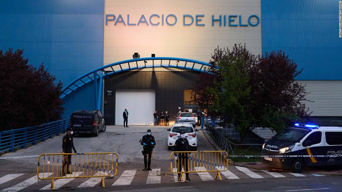 "Authorities are seen in Madrid, where an <a href=""https://edition.cnn.com/2020/03/24/europe/spain-ice-rink-morgue-coronavirus-intl/index.html"" target=""_blank"">ice rink was converted into a makeshift morgue</a> to cope with the coronavirus fallout."