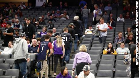 Fans exit after the Sacramento King game against the New Orleans Pelicans was postponed due to the corona virus at on March 11 in Sacramento, California.