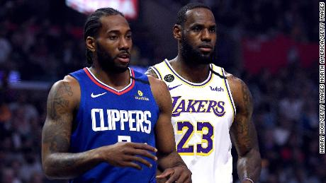 Kawhi Leonard #2 of the LA Clipper and LeBron James #23 of the Los Angeles Lakers during the first half at Staples Center on March 08, 2020 in Los Angeles, California.