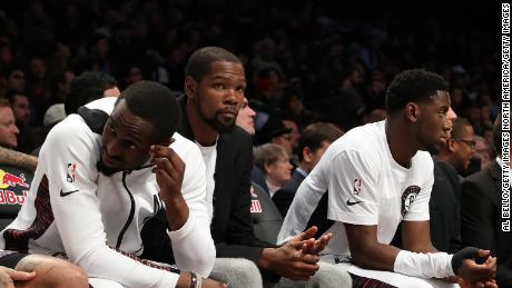 Kevin Durant (second from left) of the Brooklyn Nets is the most prominent NBA player to test positive for the coronavirus.