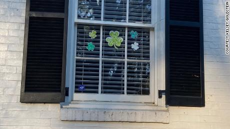 Shamrock decorations fill the windows of homes in Goldstein's Atlanta neighborhood.