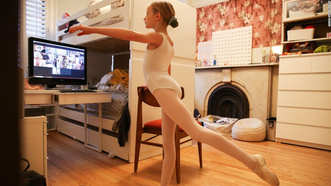 Lydia Hassebroek attends a ballet class from her home in New York on March 25, 2020.