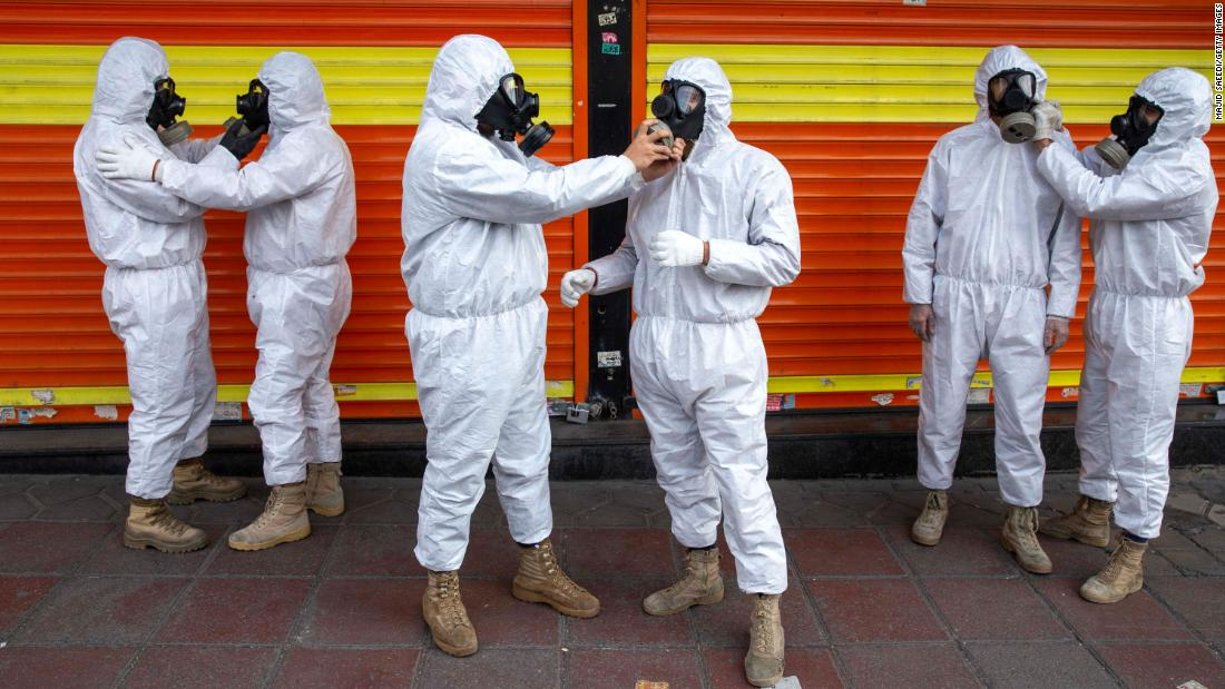 Members of Iran's Revolutionary Guard prepare to take part in disinfecting the city of Tehran on March 25.