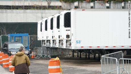 Refrigerated trailers are in place as workers build a makeshift morgue outside Bellevue Hospital in Manhattan to handle an expected surge in coronavirus victims.