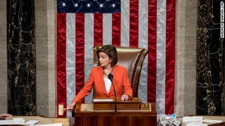 House Speaker Pelosi gavels as the House votes 232-196 to pass a resolution on impeachment procedure to move forward into the next phase of the impeachment inquiry into President Trump on October 31, 2019.