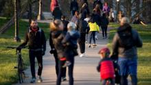People walking through Primrose Hill on March 25 in London as UK Prime Minister Boris Johnson urged people to stay at home.