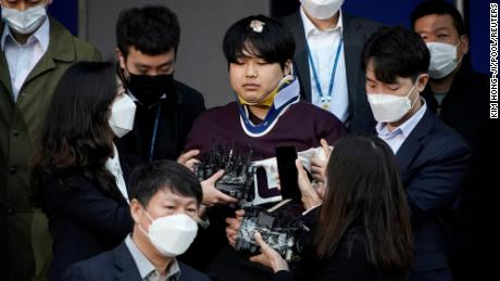 Cho Joo-bin, who allegedly ran an online sexual blackmail ring, walks out of a police station as he is transferred to a prosecutor's office in Seoul, South Korea, on March 25.