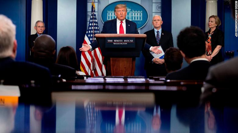 US President Donald Trump, flanked by (From L) Director of the National Institute of Allergy and Infectious Diseases Anthony Fauci, US Vice President Mike Pence and Response coordinator for White House Coronavirus Task Force Deborah Birx, speaks during the daily briefing on the novel coronavirus, COVID-19, in the Brady Briefing Room at the White House on March 26, 2020, in Washington, DC.