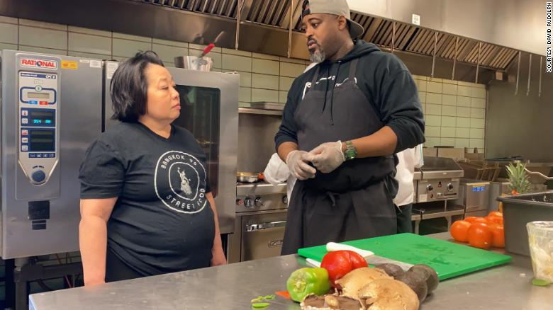 Genevieve Vang of Bangkok 96 Street Food and Maxcel Hardy of Coop Caribbean Fusion discuss plans for the day's menu.