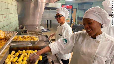 Culinary students from Greenhorn Training Solutions and local non-profit Focus Hope volunteer to help cook meals.