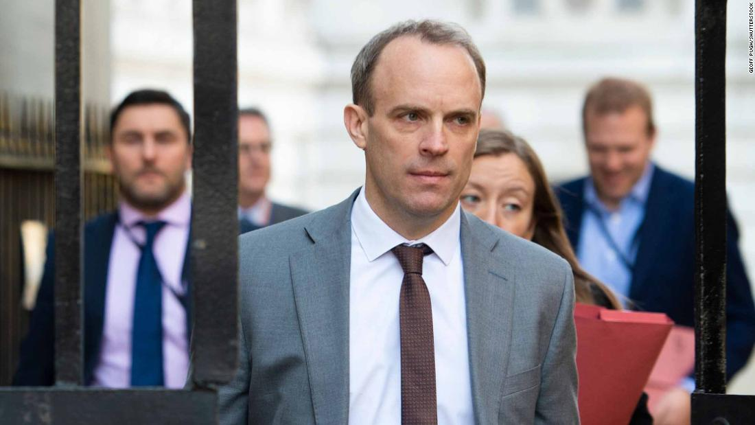 Mandatory Credit: Photo by Geoff Pugh/Shutterstock (10595248f) The Foreign Secretary Dominic Raab arrives in Downing Street with his team. Politicians in London, UK - 26 Mar 2020