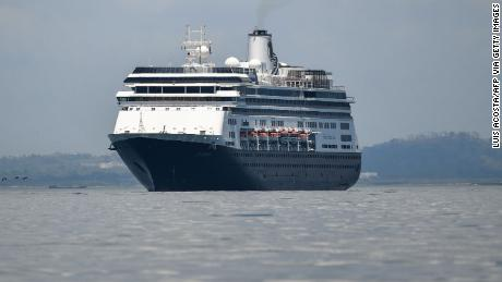 The Zaandam cruise ship enters the Panama City Bay to be assisted by the Rotterdam cruise ship with supplies, personnel and COVID-19 testing devices, at 8 milles from Panama City, on March 27, 2020. - Panama allowed medical assistance at sea for the Zaandam cruise ship with dozens of people with flu symptoms on board amid the coronavirus pandemic outbreak, but denied the Dutch-flagged cruiser Zaandam transit through the Panama Canal, announced the administrator of the maritime route, Ricaurte Vásquez, who also said that the ship will be quarantined if any case of the new coronavirus is confirmed on board. (Photo by Luis Acosta / AFP) (Photo by LUIS ACOSTA/AFP via Getty Images)