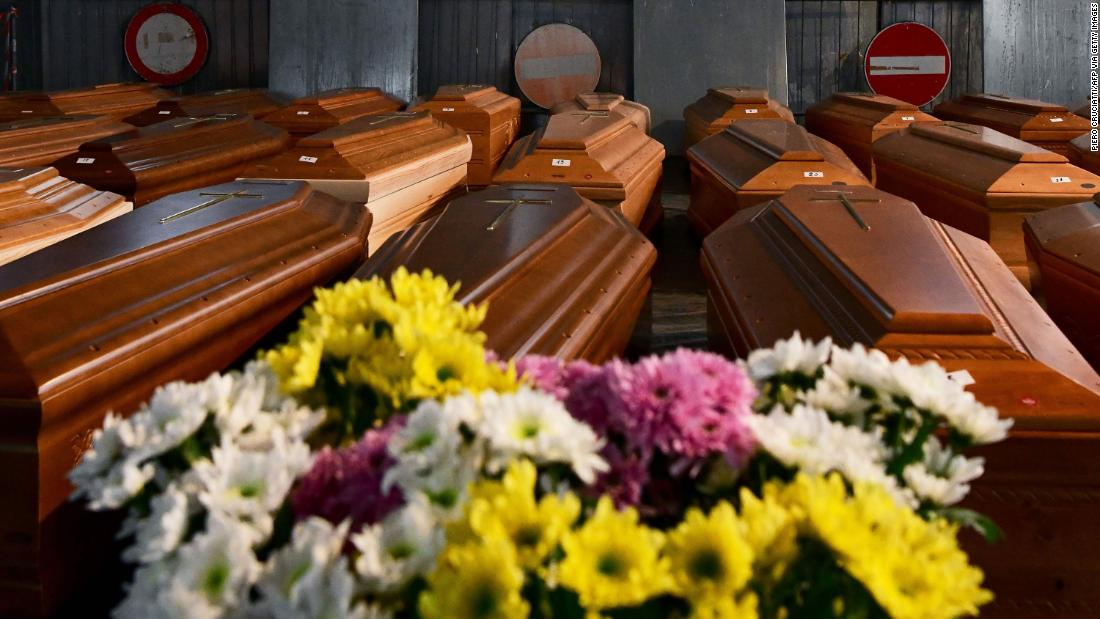 Coffins carrying coronavirus victims are stored in a warehouse in Ponte San Pietro, Italy, on March 26. They would be transported to another area for cremation.