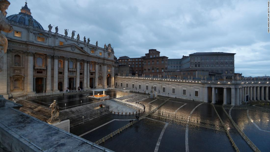 Pope Francis prays in an empty St. Peter's Square on March 27, 2020.