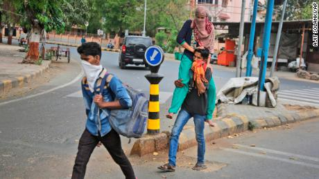 Migrant workers from state of Rajasthan leaving for their village after Ahmedabad comes under lock down on Thursday, March 26.