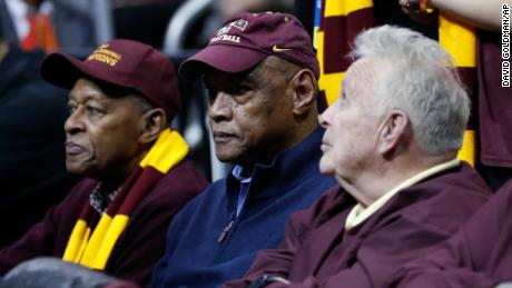 Loyola Chicago team members from 1963, from left, Jerry Harkness, Les Hunter and John Egan, watch a NCAA college basketball tournament game between Loyola and Nevada in Atlanta in March 2018. Hunter died Friday, the school said.