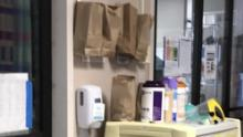 One Louisiana hospital is using brown paper bags by the ICU doors to store used masks