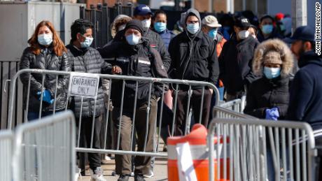 Patients wait for coronavirus testing outside Elmhurst Hospital Center in New York on Friday.