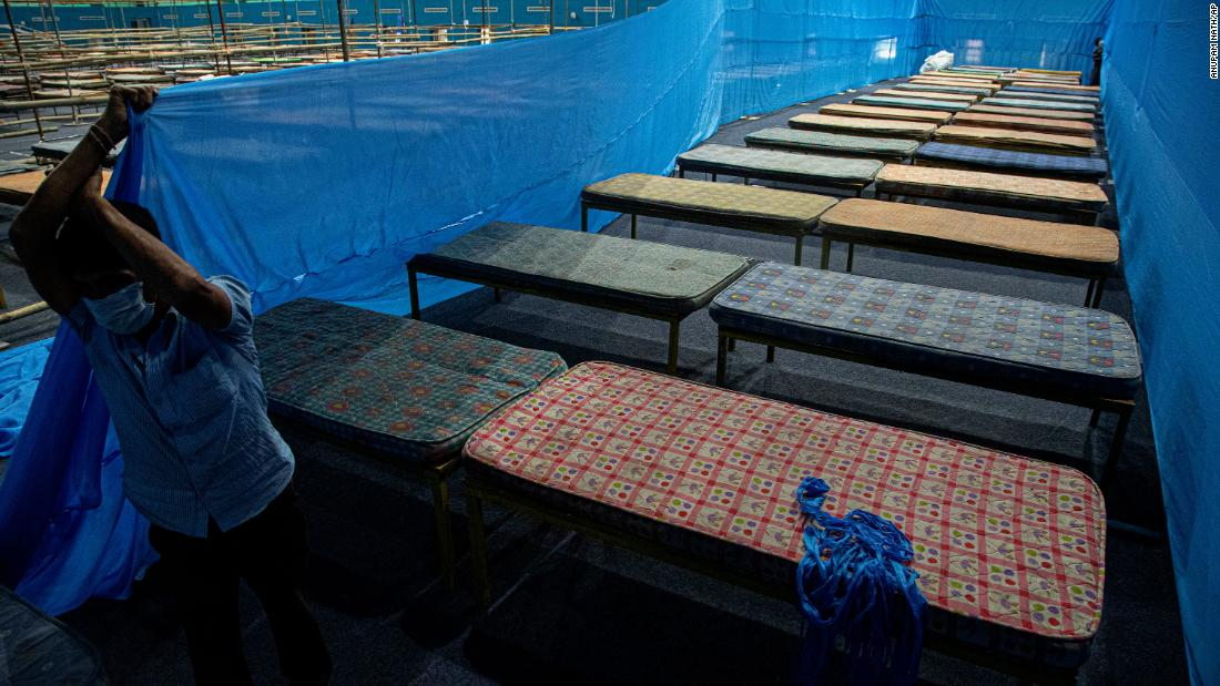 A worker fixes partitions at a quarantine center in Guwahati, India, on March 28, 2020.