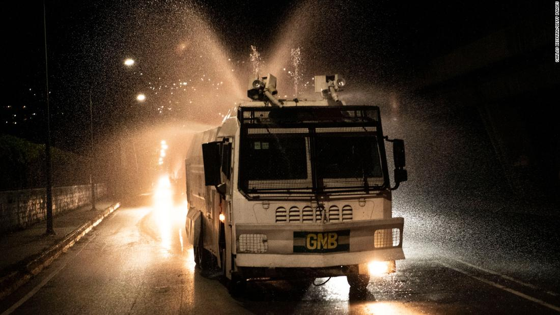 A National Guard truck sprays disinfectant in Caracas, Venezuela, on March 27, 2020.
