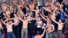 Many fans supported their team shirtless in the stands.